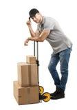 Cajas y paquetes del camión de mano del mensajero Fotografía de archivo libre de regalías