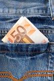 cajgów pieniądze kieszeń Zdjęcia Stock
