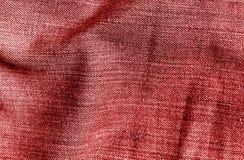 Cajg tekstylna tekstura w czerwonym kolorze Obrazy Stock