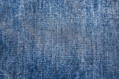 Cajgi deseniują tkaninę Używać niebiescy dżinsy tekstura dla tła zdjęcia stock