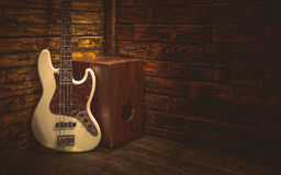 Cajon and Bass guitar. On small stage in pub Stock Photo