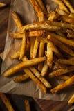 Cajun a assaisonné des pommes frites photographie stock