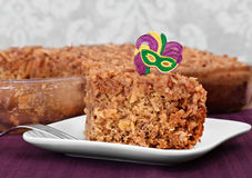 Cajun Cake. One slice of Cajun cake in front of full cake in pan. Cajun cake from bayou and part of mardi gras celebration foods