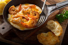 Cajun Style Shrimp and Grits. A pan of delicious fresh homemade cajun style shrimp and grits with cheddar biscuit Stock Photos