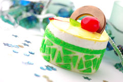 Cake. Green cake with cherry on white table Stock Photo