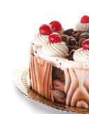 Cake. Beautiful Whole Chocolate Cake with cherries.Isolated on white.Close-up stock images