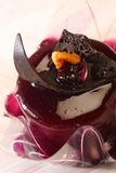 Cake. Chocolate cake with topping serve in cold Royalty Free Stock Photography
