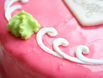 Cake. Pink cake with green and white decoration Royalty Free Stock Image