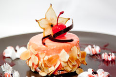 Cake. With cherry and apple on plate on white Royalty Free Stock Photography