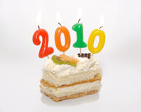 Cake with 2010 in candles Stock Image