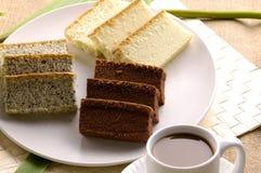 Cake. Piece of chocolate cake on mat Stock Image