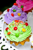 Cake. Green cup cake with candy Stock Photo