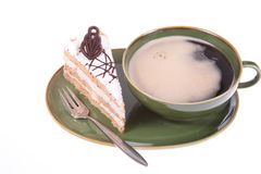 Cake. Coffee and cake on a green plate Royalty Free Stock Photos