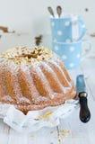 Cake. House fruitcake decorated by hazelnuts Royalty Free Stock Photos