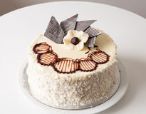 Cake. White decorated cake with coconut cuttings Stock Image