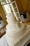 The cake. White wedding cake in a room Stock Photo