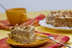 Cake. With almonds and nut on the yellow plate Royalty Free Stock Photos