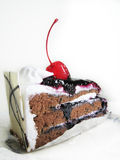 Cake. A isolated of black forest cake with cherry on top and white chocolate Stock Photography