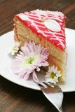 Cake. A slice of a cream cake and flowers stock image