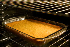 Corn cake baking in oven Royalty Free Stock Photography