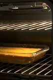 Corn Cake in Open Oven Stock Images