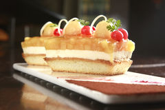Cake. Pieces of fruit cake with apple, cherry and orange Royalty Free Stock Photos