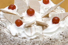 Cake. Fresh cream cake with sugared cherry and chocolate pieces Stock Photo