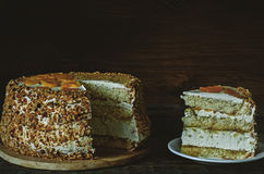 Cake with almonds; cream, cheesecake and caramelised mango Royalty Free Stock Photography