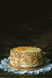 Cake with almonds; cream, cheesecake and caramelised mango Royalty Free Stock Photo