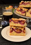 Cake with almonds and plums. Autumn colors, sweet and bitters aromas from the kitchen, made me to prepare this cake with almonds and plums Royalty Free Stock Images