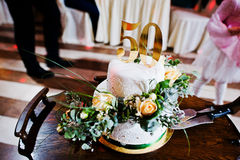 Cake anniversary in 50 at table Stock Images