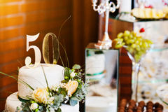 Cake anniversary in 50 at table Royalty Free Stock Photography