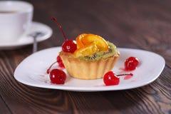 Cake. With apelsiinom, kiwi and cherry stock photos