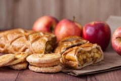Cake with Apple filling and pastry with apples stock images