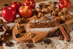 Cake with apples, nuts and cinnamon Stock Photography
