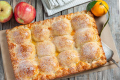 Cake with apples and tangerines Stock Photography