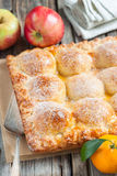 Cake with apples and tangerines Stock Images