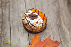 Cake and autumn yellow maple leaf Royalty Free Stock Photography