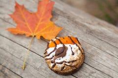 Cake and autumn yellow maple leaf Stock Photo