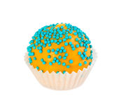Cake ball in yellow glaze with blue sprinkles Royalty Free Stock Photography