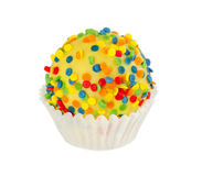 Cake ball in yellow glaze with colorful sprinkles Royalty Free Stock Photo