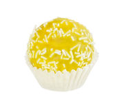 Cake ball in yellow glaze with white sprinkles in paper form Royalty Free Stock Images