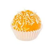 Cake ball in yellow glaze with white sprinkles Royalty Free Stock Photography
