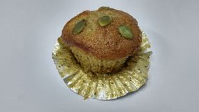 Cake. Banana cup cake in the white bachgound Royalty Free Stock Photos
