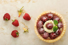 Cake basket with fresh raspberries and cream fruit dessert. On a marble background - top view Stock Images