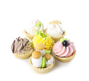 Cake basket in the sand with cream Royalty Free Stock Images