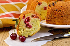 Cake with berries cherries and napkin on the board Stock Photography