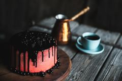 Cake berries close up coffee on wood table stock image