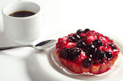 Cake with berries and coffee Stock Images