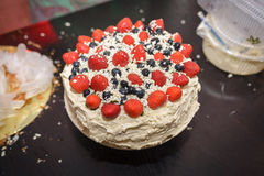 Cake with berries and cream stock images